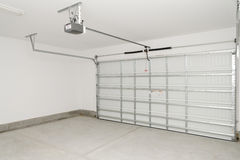 Residential house garage. Door inside view with electric opener Stock Photography