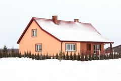 Residential house in gray winter day Royalty Free Stock Images
