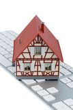 Residential house on keyboard Stock Photography