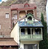 Residential house at the rock. With a balcony and colorful tiles Stock Images