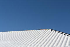 Residential house roof covered with snow. Stock Image