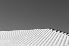Residential house roof covered with snow. Royalty Free Stock Photography
