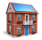 Residential house with solar batteries on the roof Stock Photo