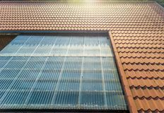 Residential house with tin roof and transparent corrugated sheets as terrace roofing royalty free stock photo