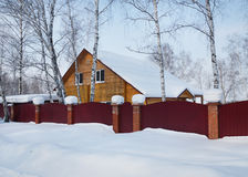 Residential house in the winter forest Stock Photo