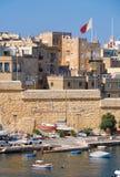 A residential houses behind enceinte along Kalkara creek, Malta. BIRGU, MALTA - JULY 26, 2015:  view of the residential houses behind enceinte along Kalkara Stock Photos
