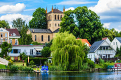 Residential houses and church at the Wannsee in Berlin, Germany royalty free stock image