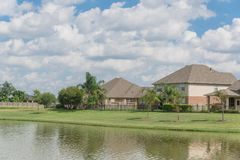 Residential houses by the lake in Pearland, Texas, USA.  Stock Photo