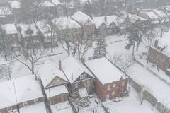 Residential houses and roofs covered with snow in winter snowstorm in Toronto royalty free stock image