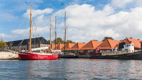 Residential houses and sailing ships in Copenhagen Stock Photo