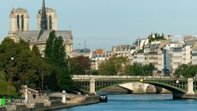 Residential houses on the Seine river embankment and famous Notre-Dame Cathedral Stock Photo