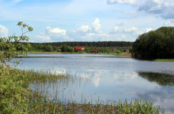Residential houses on the shore of the lake Stock Photography