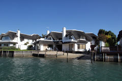 Residential houses in St Francis Bay, South Africa. Typical thatched houses at the canals of St Francis Bay, South Africa Stock Photo