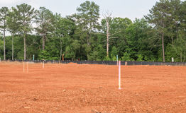 Residential Lot Staked Out. In Dirt Royalty Free Stock Images