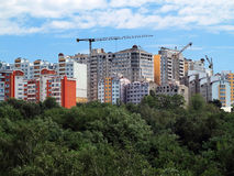 Residential modern apartment house, green forest and blue sky Royalty Free Stock Image
