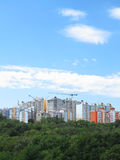 Residential modern apartment house, green forest and blue sky Royalty Free Stock Photo