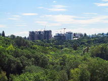 Residential modern apartment house, green forest and blue sky Royalty Free Stock Photos