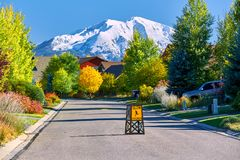 Residential neighborhood in Colorado at autumn. Slow children at play street sign at residential neighborhood in Colorado at autumn, USA. Mount Sopris landscape royalty free stock photo