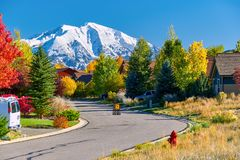Residential neighborhood in Colorado at autumn. Slow children at play street sign at residential neighborhood in Colorado at autumn, USA. Mount Sopris landscape royalty free stock images