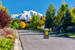 Residential neighborhood in Colorado at autumn. Slow children at play street sign at residential neighborhood in Colorado at autumn, USA. Mount Sopris landscape royalty free stock photos