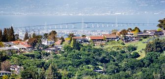Residential neighborhood on the hills of San Francisco peninsula, Silicon Valley, San Mateo bridge in the background, California royalty free stock image
