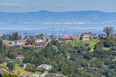 Residential neighborhood on the hills of San Francisco peninsula, Silicon Valley, San Mateo bridge in the background, California. Aerial view of residential royalty free stock photos