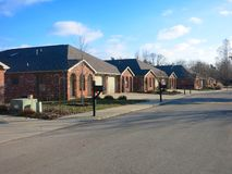 Residential Neighborhood. A residential neighborhood with neighborhoods and brick houses Stock Photo