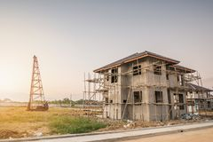Residential new house building at construction site with clouds. And blue sky Stock Photos