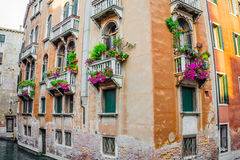 Residential old house in Venice with balconies decorated with flowers Stock Photo
