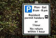 Residential Parking Restrictions Sign. Local authority roadside parking restrictions for residential areas. Between the hours of 8am until 8pm parking is Royalty Free Stock Photo