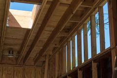 Residential renovation showing added stud wall to raise roof height. Skylight details, horizontal aspect stock image