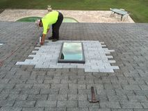 Residential Roof and Skylight Leak Repairs; Roofers Stock Photo
