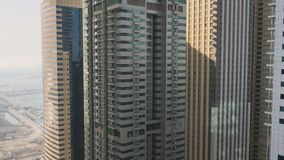 Residential skyscraper in Dubai on a sunny day. UAE. Residential skyscraper in Dubai on a sunny day. UAE stock video footage