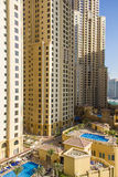 Residential skyscraper with swimming pool at Dubai Marina taken on March 24, 2013 in Dubai, United Arab Em. DUBAI - MARCH 24, 2013: Residential skyscraper with Stock Images