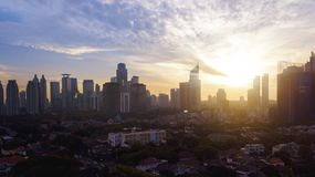 Residential and skyscrapers with beautiful sunset. Aerial view of residential and skyscrapers with beautiful sunset in Jakarta, Indonesia Stock Images