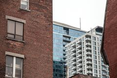 Residential skyscrapers in the dowtown of Montreal, seen from a nearby street of the main city of Quebec. Picture of residential towers during a cold and cloudy royalty free stock images