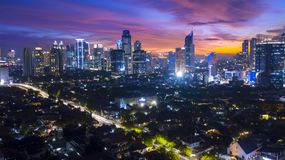 Residential and skyscrapers at nightfall. Top view of residential and skyscrapers at nightfall in Jakarta, Indonesia Royalty Free Stock Photography
