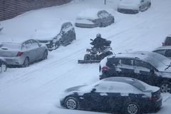 Snow removal machine. Residential snow removal machine at work, in action stock image