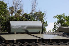 A residential solar geyser. A solar geyser fitted on top of a private residence Stock Images