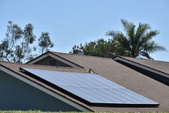 Residential Solar Panels. A residential home with solar panels installed Stock Image