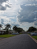 Residential Street with Dramatic Clouds Overhead Royalty Free Stock Photo