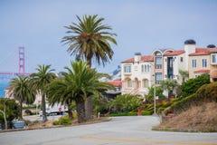 Residential street in the Sea Cliff neighborhood, San Francisco, California. Residential street in the Sea Cliff neighborhood on a sunny day, Golden Gate bridge Stock Photos