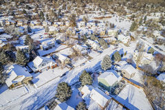 Residential street in winter scenery aerial view. Aerial  view of typical residential neighborhood along Front Range of Rocky Mountains in Colorado, winter Stock Image