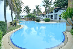 Residential swimming pool. And sea Royalty Free Stock Images
