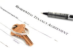Residential tenancy agreement. Blank residential tenancy agreement with pen,and keys Royalty Free Stock Image