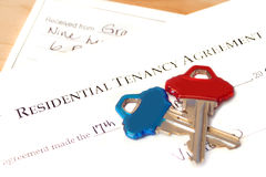 Residential tenancy agreement. Document with blue and red keys on top and a rental cheque underneath Royalty Free Stock Photo