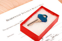 Residential tenancy agreement. Document with blue  key inside gift box Royalty Free Stock Photos