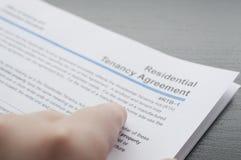Residential tenancy agreement. Woman reading residential tenancy agreement Stock Images