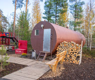Residential trailer-a barrel with a stock of firewood in  forest. Stock Photo