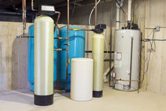 Residential water filtration. Water softener tank, neutralizer, water heater Stock Photo